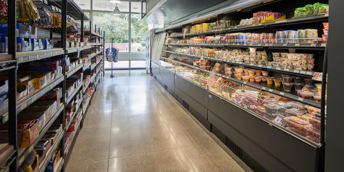The produce cooler and aisle of Market Pollock